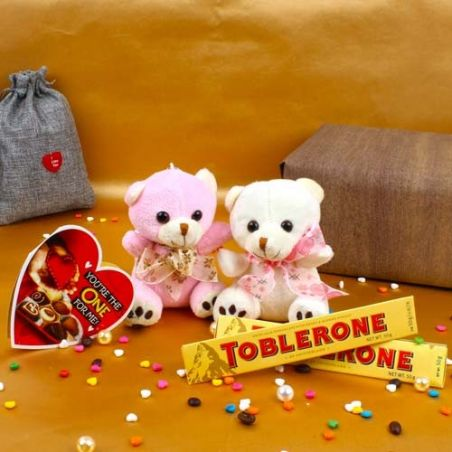 Love Season Combo of Couple Teddy with Toblerone Chocolates and Greeting Card