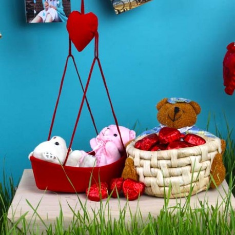 Couple Teddies Love Boat with Heart Shape Chocolates Basket