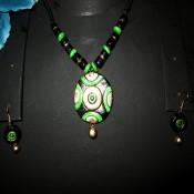 Gold-Green terracotta jewel